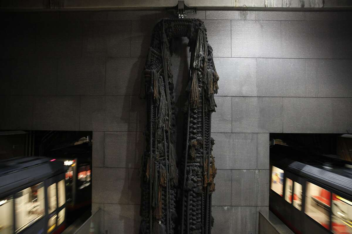 """A macrame sculpture titled """"Legs"""" by Barbara Shawcroft hangs at the east end of the Embarcadero BART station on Friday, April 26, 2013 in San Francisco, Calif."""