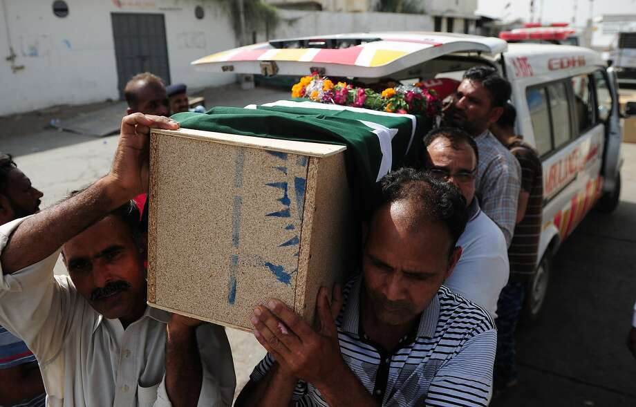 Airport Security Force personnel carry the coffin of a colleague who died in the assault by militants on the airport in Karachi. Twenty-nine people, including all 10 attackers, perished in the firefight. Photo: Asif Hassan, AFP/Getty Images