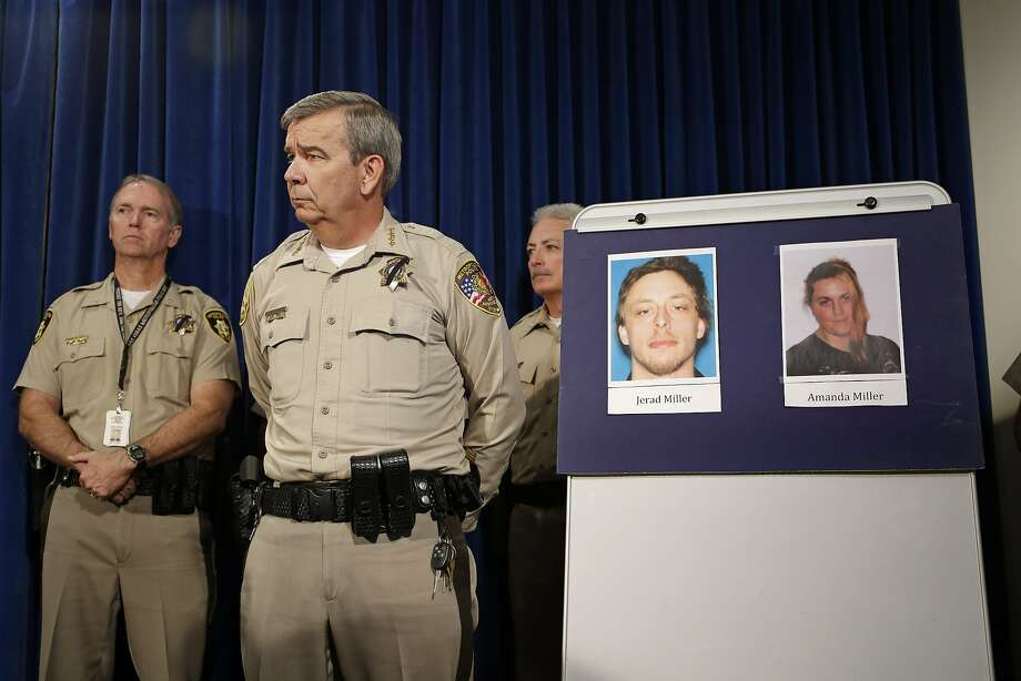 "Sheriff Doug Gillespie displays pictures of Jerad and Amanda Miller. Authorities say the Millers held an ideology shared by militia groups that law enforcement was the ""oppressor."" Photo: John Locher, Associated Press"