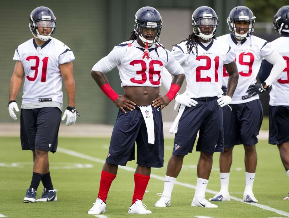 Texans defensive backs Shiloh Keo (31), D.J. Swearinger (36), Kendrick Lewis (21) and Jawanza Starling (29) line up to run a drill. Photo: Brett Coomer, Houston Chronicle