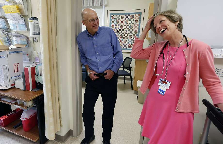 Peter Bristol of Wakefield, R.I., jokes with registered nurse and study coordinator Diane Monast after receiving an intravenous infusion at Butler Hospital in Providence, R.I. Photo: Michael Dwyer, Associated Press