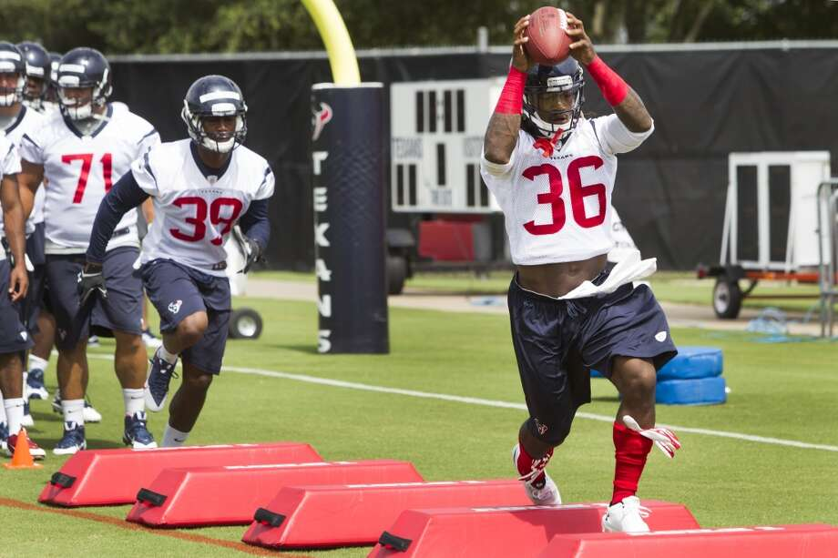 Texans safety D.J. Swearinger (36) catches a football during a drill. Photo: Brett Coomer, Houston Chronicle
