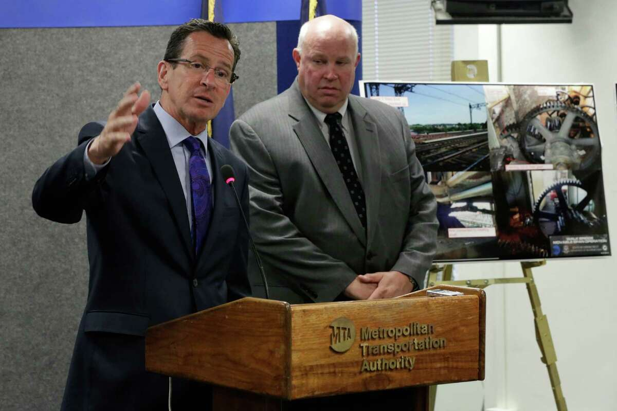 Connecticut Gov. Dannel Malloy, left, accompanied by MTA Chairman and CEO Thomas Prendergast, addresses a news conference at MTA headquarters, in New York, Monday, June 9, 2014. Malloy and officials of the New York region's commuter transit system have announced they will review detailed operations of a 118-year-old bridge over the Norwalk River, along the Metro-North Railroad, that has failed twice in less than two weeks, delaying the commutes of thousands of riders into and out of New York City.