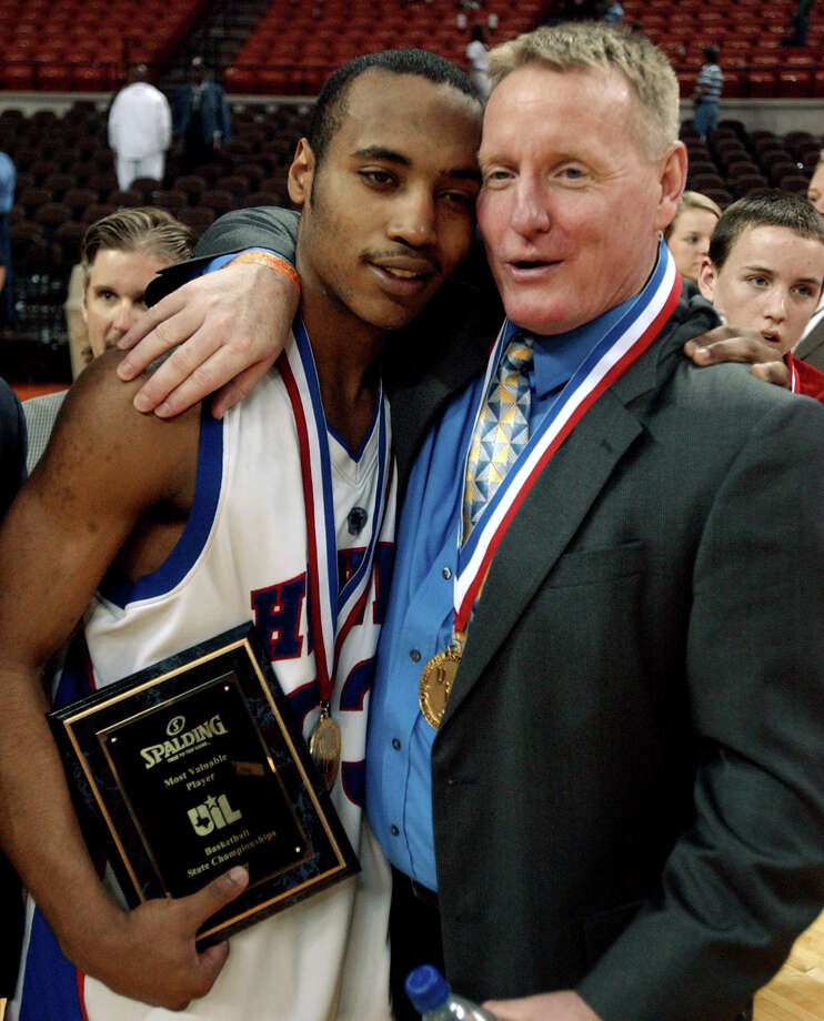 Hardin-Jefferson coach Todd Sutherland (right) and Texas state championship MVP Ryan Donahoe (left) hug after the game in Austin on March 10, 2007. The Hawks beat Abilene Wylie 56-44. The Hardin-Jefferson girls and boys were the third part of the Southeast Texas Champions series which was published on  Feb. 14. Enterprise file photo Photo: Mark M. Hancock, Photojournalist / The Beaumont Enterprise