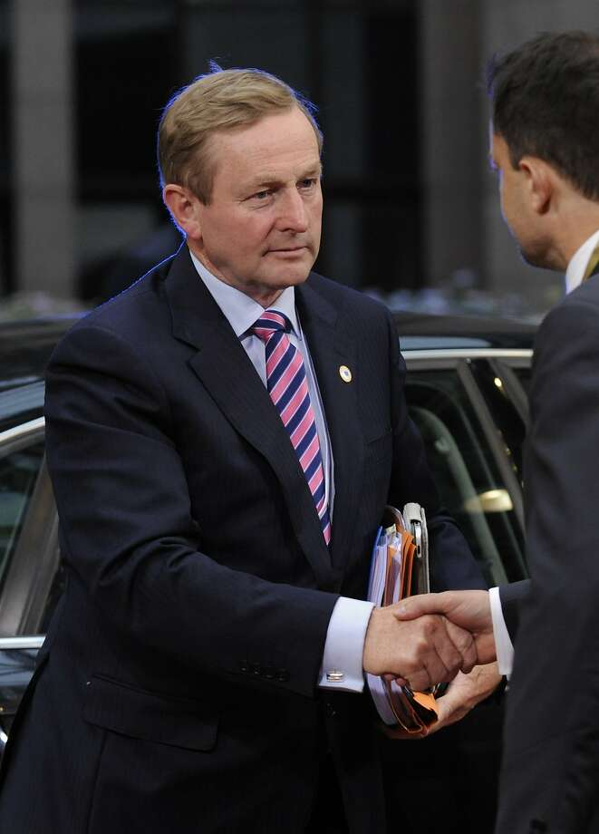 Irish Prime Minister Enda Kenny shakes hands with a protocol official at the European Council building in Brussels, Tuesday, May 27, 2014. European Union leaders on Tuesday sought a way to bounce back from the weekend's landmark elections that saw a partly hostile and largely apathetic public question their project of closer cooperation as never before. (AP Photo/Eric Vidal) Photo: Eric Vidal, Associated Press