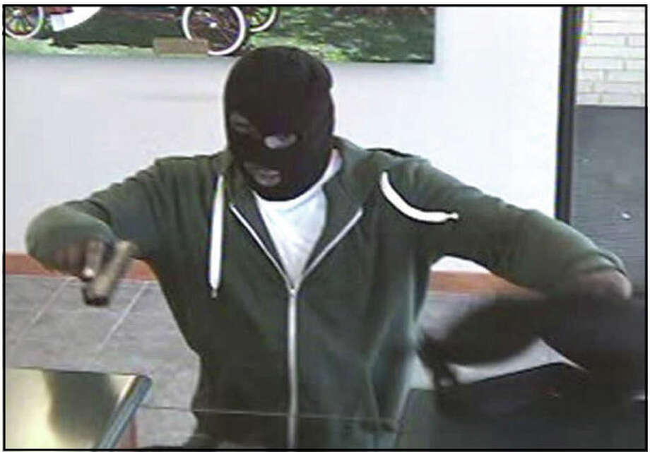 Fairfield police are looking for this suspect, who they said robbed the TD Bank branch at 1643 Post Road just before closing on Sunday. Photo: Contributed Photo, Genevieve Reilly /  Fairfield Citizen contributed