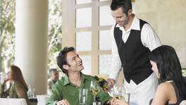Waiter Serving Couple in Restaurant tipping tip   By:  moodboard - Mike Watson    Collection:  Brand X Pictures