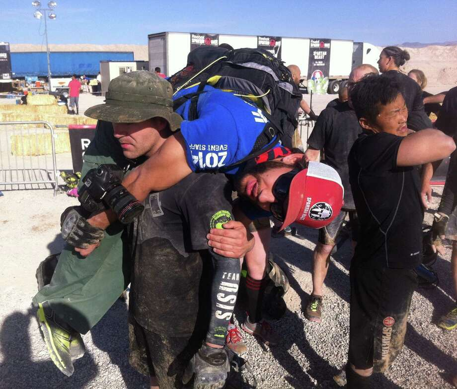 First Lt. Chris Givens carries another Hurricane Heat participant in April. Teams of two travel 100 yards and back, switching to carry the other contestant to complete the distance. Photo: Courtesy Photos