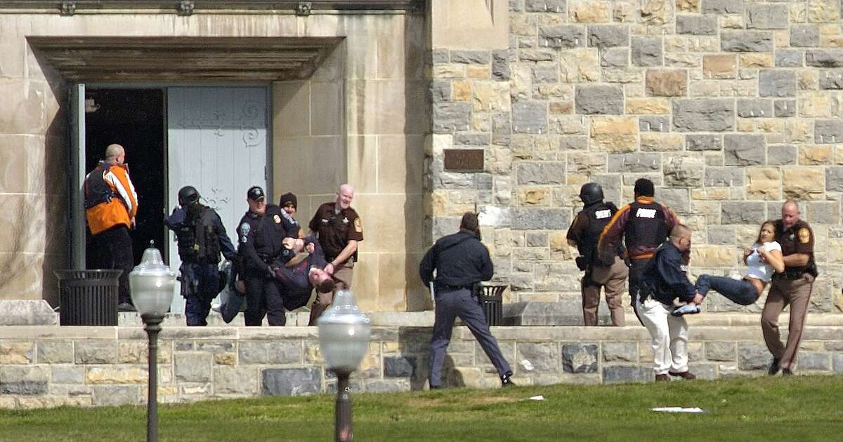 Injured occupants are carried out of Norris Hall at Virginia Tech in Blacksburg, Va., Monday, April 16, 2007. A gunman opened fire in a dorm and classroom on the campus, killing at least 30 people in the deadliest shooting rampage in U.S. history. The gunman is killed but it's unclear if he was shot by police or took his own life. (AP Photo/The Roanoke Times, Alan Kim) Ran on: 04-17-2007 Top: Security people take wounded people out of Norris Hall; a gunman killed 31 people there, including himself. His first attack was at a dorm about two hours earlier. Above: Students console one another after a services at the War Memorial Chapel in the middle of the campus, between Norris Hall and the dormitory. Ran on: 04-17-2007 Top: Police take wounded people out of Norris Hall; a gunman killed 31 people there, including himself. His first attack was at a coed dorm more than two hours earlier. Above: Students console one another after a service at the War Memorial Chapel in the middle of the campus, between Norris Hall and the dormitory.