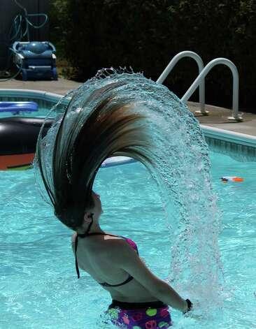 Addie Colligan, 13, of Nassau, flips her hair for a dazzling camera shot by Cori Bichteman of Albany who was practicing shutter speed. (Cori Bichteman)