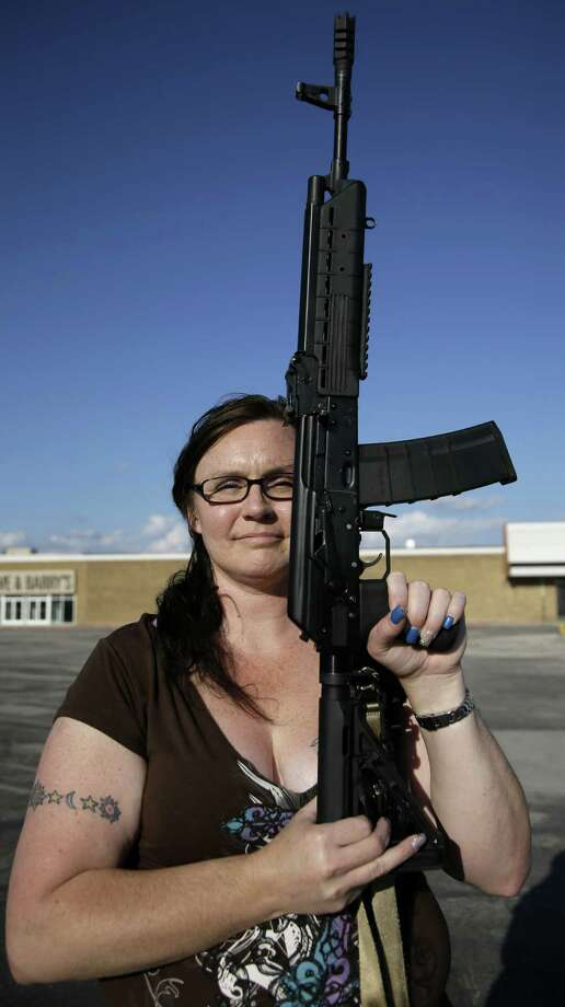 Tara Cowan, a member of Open Carry Tarrant County, poses with a Saiga 556 rifle during a demonstration last month in Haltom City. A reader says the National Rifle Association was wrong to soften its stance against such organizations. Photo: Tony Gutierrez / Associated Press / AP