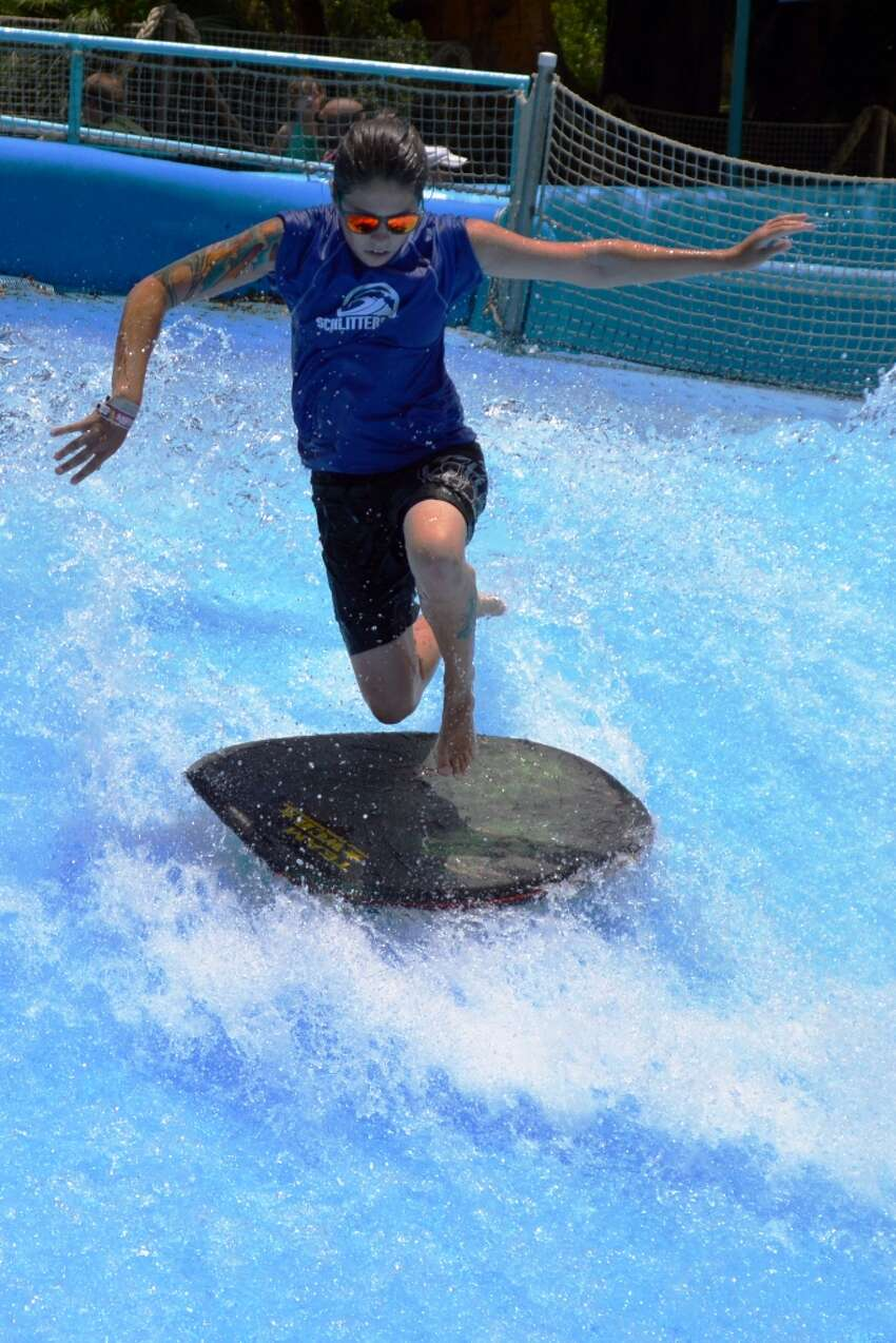 A rider shows her moves at last year's Boogie Bahn Classic Surf Competition Tour. Surfers ride the rush of 50,000 gallons of water per minute on the Boogie Bahn Surfing Ride.