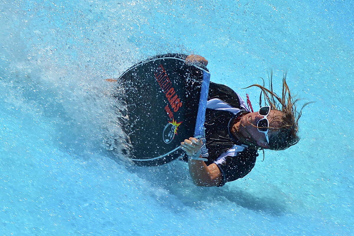 A rider wipes out at last year's Boogie Bahn Classic Surf Competition Tour. This year's tour starts Tuesday at the Schlitterbahn in New Braunfels. Surfers have 2 minutes to show the judges their best skills on the Boogie Bahn Surfing Ride.
