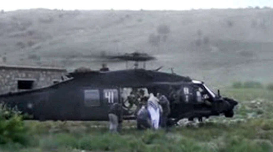 Sgt. Bowe Bergdahl (in white) is led toward a helicopter in eastern Afghanistan after being freed. Maybe the price for his release was too steep. Then again, how could the nation believe he should have been left to die in Taliban custody? Photo: Voice Of Jihad Website / Voice Of Jihad Website