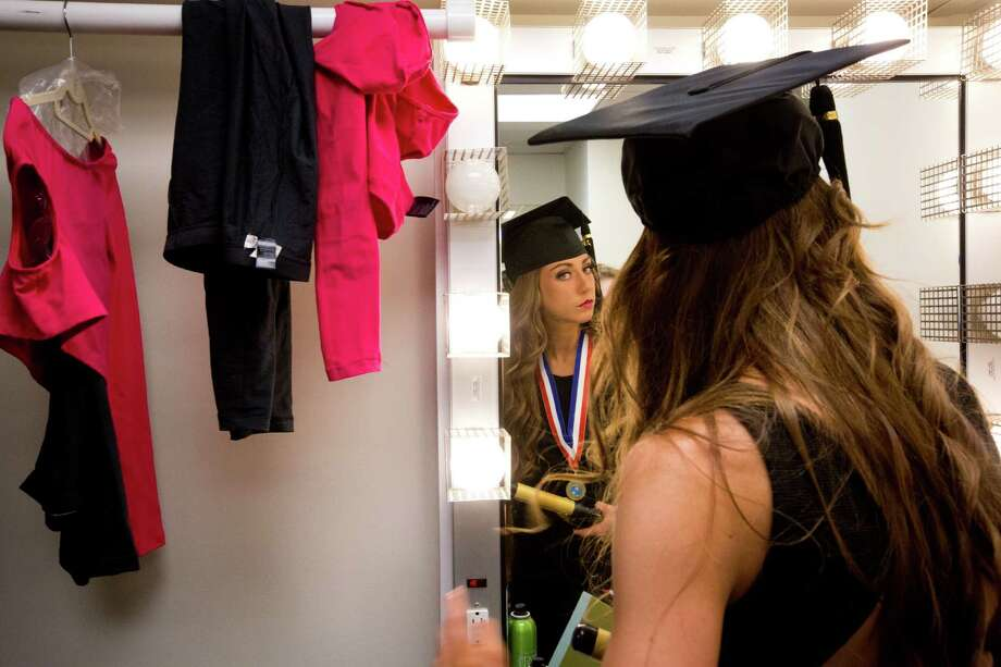 Morgan Clay, 18, a senior dance student at The High School for the Performing and Visual Arts prepares to graduate with her fellow dance classmates, Tuesday, June 3, 2014, in Houston. Clay will continue her education at the Louisiana State University this coming fall. Photo: Marie D. De Jesus, Houston Chronicle / © 2014 Houston Chronicle