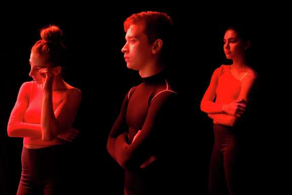 Morgan Clay, left, Dylan Allen, center, and Victoria Price listen to their teachers critique during a dress rehearsal at The Hobby Center for the Performing Arts, hours before their graduation performance, Tuesday, June 3, 2014, in Houston.