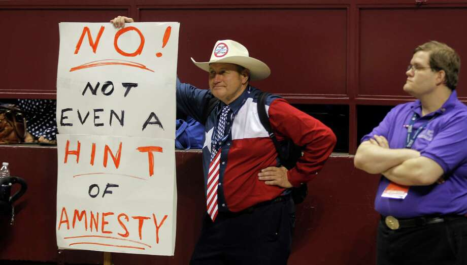 Jack Finger, left of San Antonio, holds a sign showing his feelings on the immigration question during the third day of the Texas Republican Convention at the Fort Worth Convention Center in Fort Worth, TX, Saturday, June 7, 2014. (Star-Telegram/Rodger Mallison) Photo: Rodger Mallison, STF / Fort Worth Star-Telegram