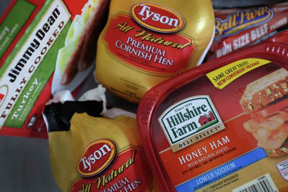 FILE - JUNE 9, 2014: It was reported that Tyson Foods Inc. has won a bidding war for Hillshire Brands with a $7.75 billion ($63 per share) offer beating out rival Pilgrim's Pride June 9, 2014. MIAMI, FL - MAY 29:  In this photo illustration, Tyson Food and Hillshire Brands food products are seen on May 29, 2014 in Miami, Florida. Tyson Foods made a $ 6.8 billion all-cash proposal to aquire Hillshire Brands whose brands include among others Jimmy Dean sausages and Ball Park hot dogs.  (Photo by Joe Raedle/Getty Images) ORG XMIT: 494973359 Photo: Joe Raedle / 2014 Getty Images