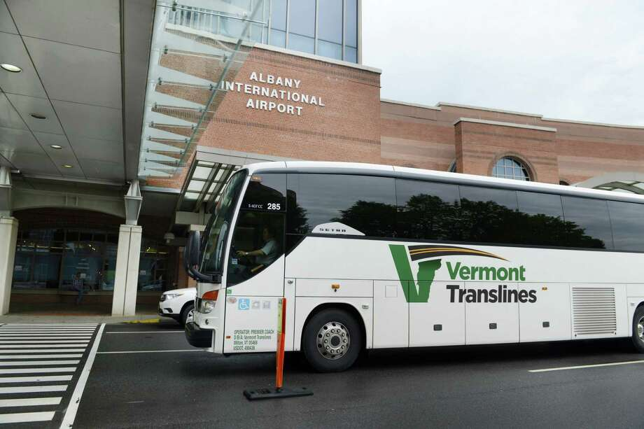 A Vermont Translines bus departs from Albany International Airport Monday afternoon, June 9, 2014, in Colonie, N.Y. Vermont Translines began daily bus service from the airport to Vermont destinations along Route 7 and, with transfer, Route 4. The daily bus also makes a stop at the Greyhound/Trailways terminal in Albany. The new routes are partially funded by the Vermont Agency for Transportation and the Federal Transit Administration. (Will Waldron/Times Union) Photo: WW / 00027268A