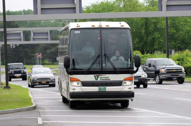 A Vermont Translines bus arrives at Albany International Airport Monday afternoon, June 9, 2014, in Colonie, N.Y. Vermont Translines began daily bus service from the airport to Vermont destinations along Route 7 and, with transfer, Route 4. The daily bus also makes a stop at the Greyhound/Trailways terminal in Albany. The new routes are partially funded by the Vermont Agency for Transportation and the Federal Transit Administration. (Will Waldron/Times Union) Photo: WW / 00027268A
