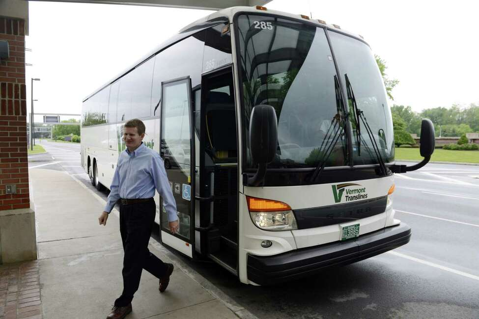 Chip Desautels, sales manger and assistant general manager for Vermont Translines, arrives by bus at Albany International Airport Monday afternoon, June 9, 2014, in Colonie, N.Y. Vermont Translines began daily bus service from the airport to Vermont destinations along Route 7 and, with transfer, Route 4. The daily bus also makes a stop at the Greyhound/Trailways terminal in Albany. The new routes are partially funded by the Vermont Agency for Transportation and the Federal Transit Administration. (Will Waldron/Times Union)