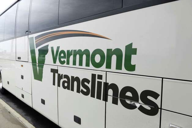 Exterior of a Vermont Translines, arrives by bus at Albany International Airport Monday afternoon, June 9, 2014, in Colonie, N.Y. Vermont Translines began daily bus service from the airport to Vermont destinations along Route 7 and, with transfer, Route 4. The daily bus also makes a stop at the Greyhound/Trailways terminal in Albany. The new routes are partially funded by the Vermont Agency for Transportation and the Federal Transit Administration. (Will Waldron/Times Union) Photo: WW / 00027268A
