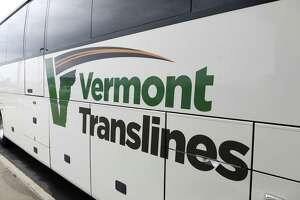 Exterior of a Vermont Translines, arrives by bus at Albany International Airport Monday afternoon, June 9, 2014, in Colonie, N.Y. Vermont Translines began daily bus service from the airport to Vermont destinations along Route 7 and, with transfer, Route 4. The daily bus also makes a stop at the Greyhound/Trailways terminal in Albany. The new routes are partially funded by the Vermont Agency for Transportation and the Federal Transit Administration. (Will Waldron/Times Union)