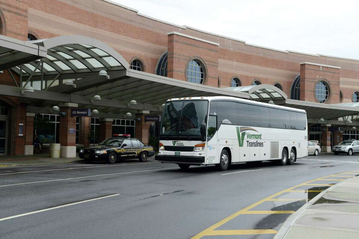 A Vermont Translines bus departs from Albany International Airport Monday afternoon, June 9, 2014, in Colonie, N.Y. Vermont Translines began daily bus service from the airport to Vermont destinations along Route 7 and, with transfer, Route 4. The daily bus also makes a stop at the Greyhound/Trailways terminal in Albany. The new routes are partially funded by the Vermont Agency for Transportation and the Federal Transit Administration. (Will Waldron/Times Union)