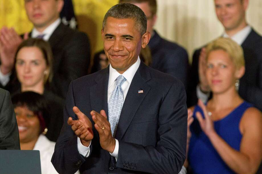 President Barack Obama applauds during an event in the East Room of the White House in Washington, Monday, June 9, 2014, where he signed a Presidential Memorandum on reducing the burden of student loan debt. The president said the rising costs of college have left America's middle class feeling trapped. He says no hard-working youngster in America should be priced out of a higher education. Obama signed a presidential memorandum he says could help an additional 5 million borrowers.  (AP Photo/Jacquelyn Martin) Photo: Jacquelyn Martin, STF / AP