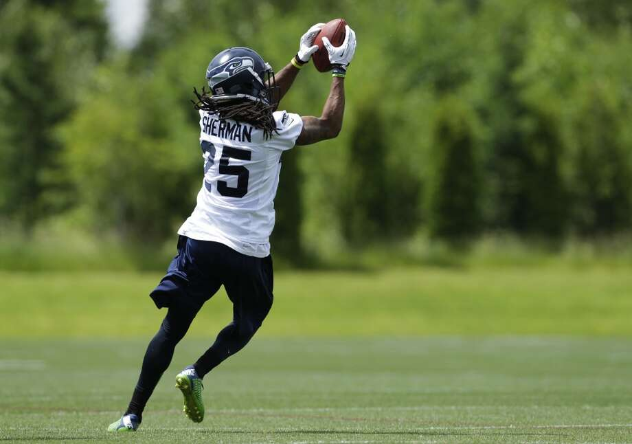 Seattle Seahawks cornerback Richard Sherman makes a catch during Seahawks OTAs on Monday. Photo: Ted S. Warren, Associated Press