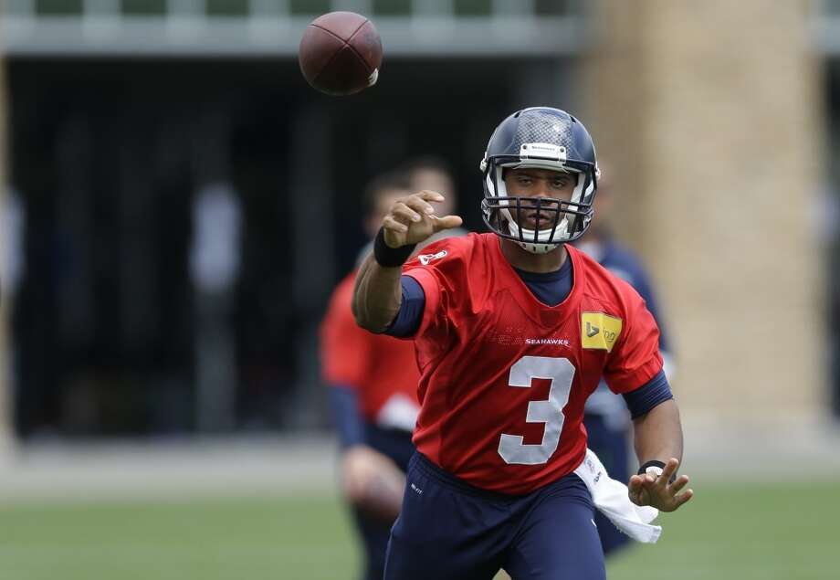 Seattle Seahawks quarterback Russell Wilson passes during a practice drill at Seahawks OTAs on Monday. Photo: Ted S. Warren, Associated Press