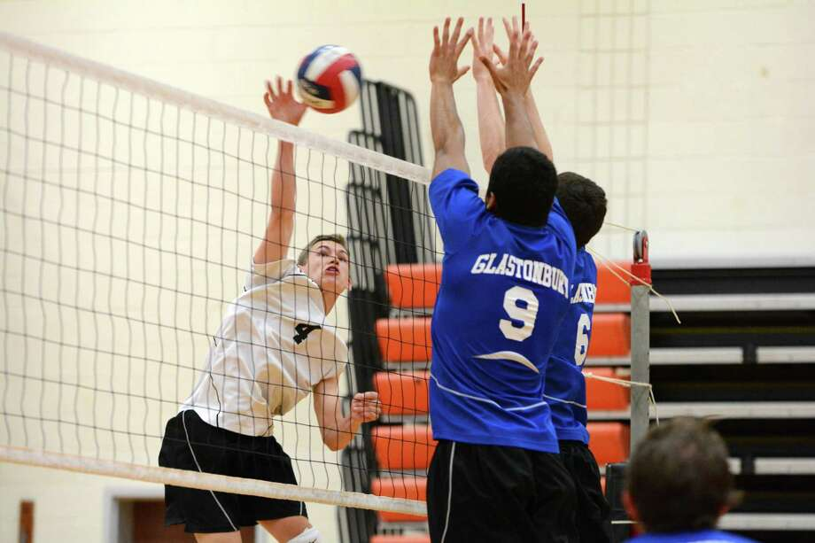 Ridgefield's Mark Liguori (4) sends the ball over the net during the high school boys volleyball Class L state semifinals against Glastonbury at Shelton High School on Monday, June 9, 2014. Photo: Amy Mortensen / Connecticut Post Freelance