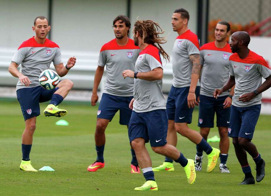The U.S. team, including Dynamo midfielder Brad Davis, left, wasted no time hitting the field after arriving in Brazil on Monday, holding a training session in Sao Paulo. The Americans' first match is Monday against Ghana in Natal. Photo: Julio Cortez, STF / AP