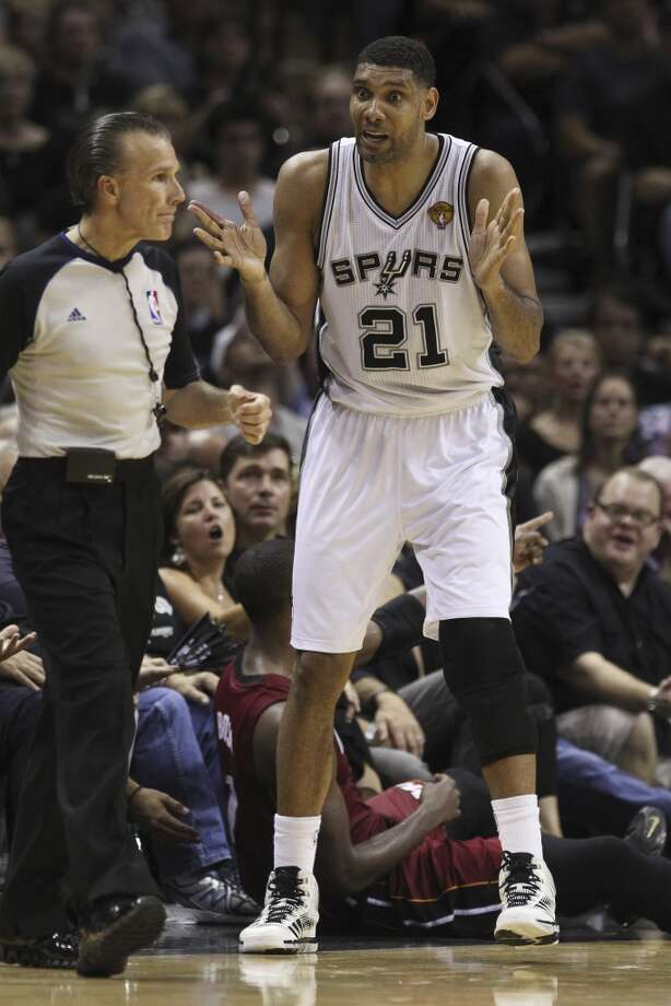 Spurs' Tim Duncan (21) debates with a game official after fouling Miami Heat's Chris Bosh (01) in the second half of Game 1 of the 2014 NBA Finals at the AT&T Center on Thursday, June 5, 2014. Spurs defeat the Heat, 110-95. Photo: Kin Man Hui, San Antonio Express-News