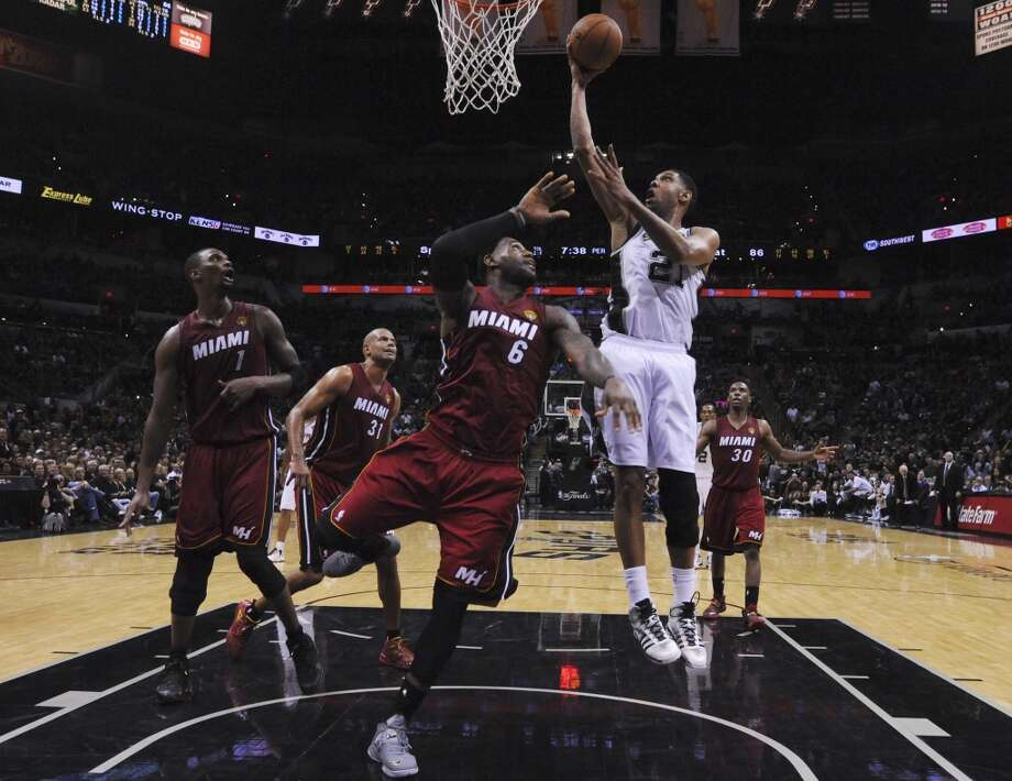 Spurs' Tim Duncan (21) goes up for a shot against Miami Heat's LeBron James (06) in the second half of Game 1 of the 2014 NBA Finals at the AT&T Center on Thursday, June 5, 2014. Photo: Kin Man Hui, San Antonio Express-News