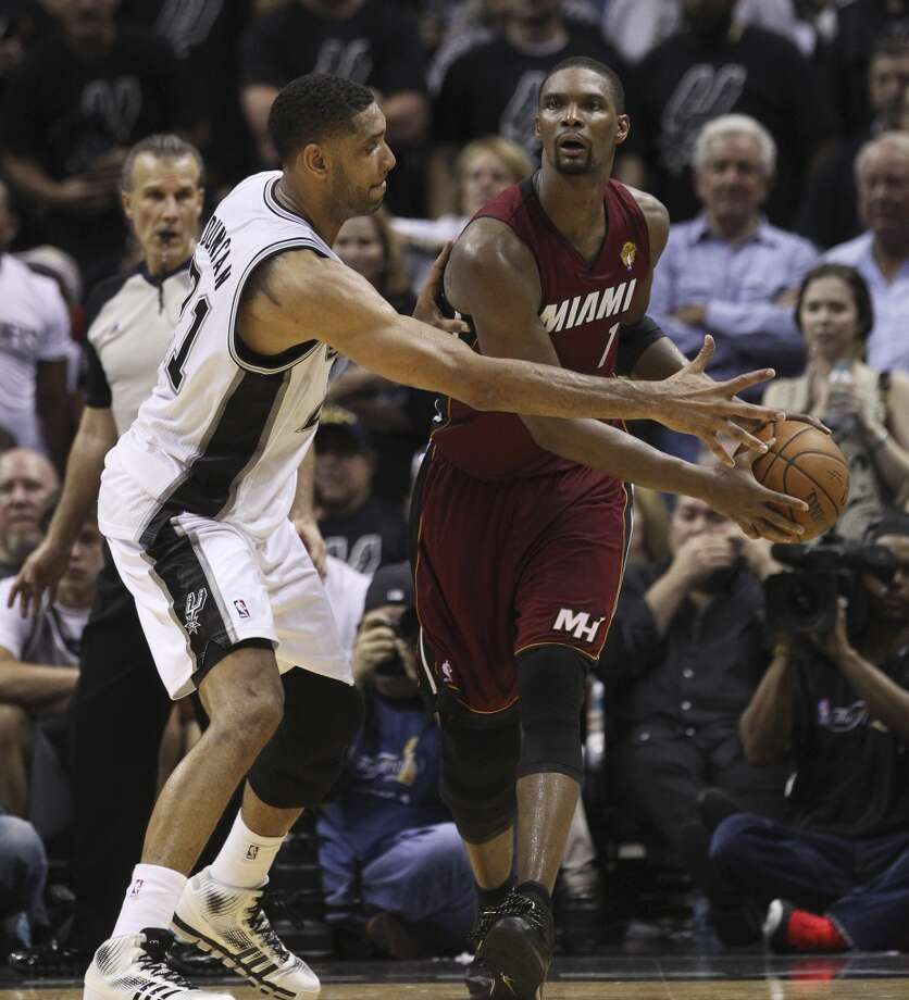 Spurs' Tim Duncan (21) puts defensive pressure on Miami Heat's Chris Bosh (01) in the second half of Game 1 of the 2014 NBA Finals at the AT&T Center on Thursday, June 5, 2014. Spurs defeat the Heat, 110-95. Photo: Kin Man Hui, San Antonio Express-News