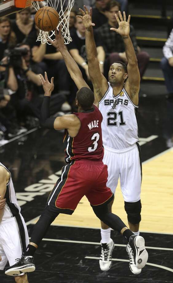 San Antonio Spurs' Tim Duncan attempts to defend against Miami Heat's Dwyane Wade during the first half at the AT&T Center, Thursday, June 5, 2014. T Photo: Jerry Lara, San Antonio Express-News