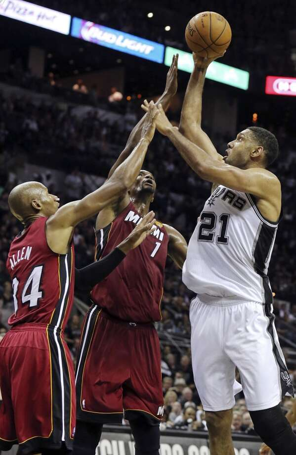 San Antonio Spurs' Tim Duncan shoots over Miami Heat's Ray Allen (left) and Chris Bosh during first half action in Game 1 of the NBA Finals Thursday June 5, 2014 at the AT&T Center. Photo: Edward A. Ornelas, San Antonio Express-News