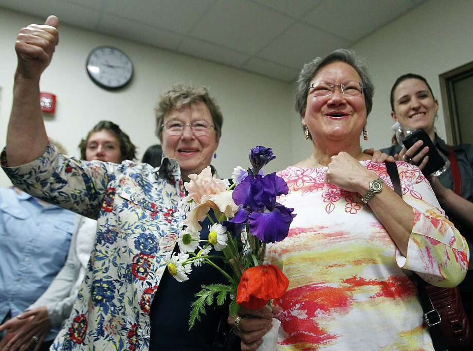 Miriam Douglass, left, and Ligia Rivera celebrate the announcement that same-sex marriage licenses would be granted in Outagamie County, Wis.  Photo: Wm.Glasheen, MBR / Post-Crescent Media