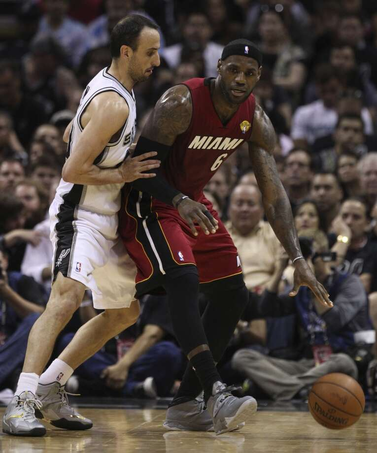 Spurs' Manu Ginobili (20) defends Miami Heat's LeBron James (06) in the first quarter of Game 1 of the 2014 NBA Finals at the AT&T Center on Thursday, June 5, 2014. Photo: Kin Man Hui, San Antonio Express-News