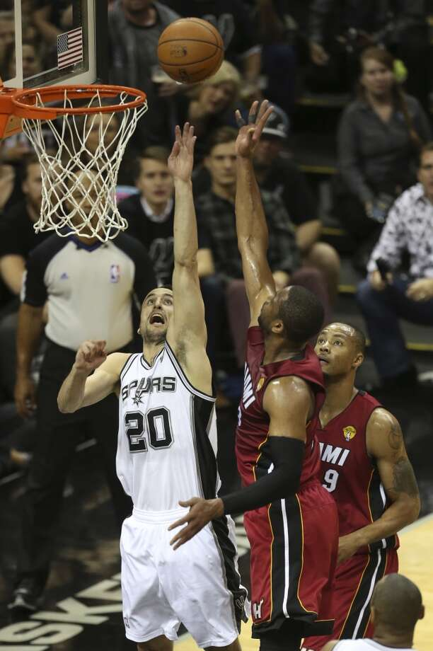 San Antonio Spurs' Manu Ginobili attempts to defend a shot by Miami Heat's Dwyane Wade during the first half at the AT&T Center, Thursday, June 5, 2014. T Photo: Jerry Lara, San Antonio Express-News