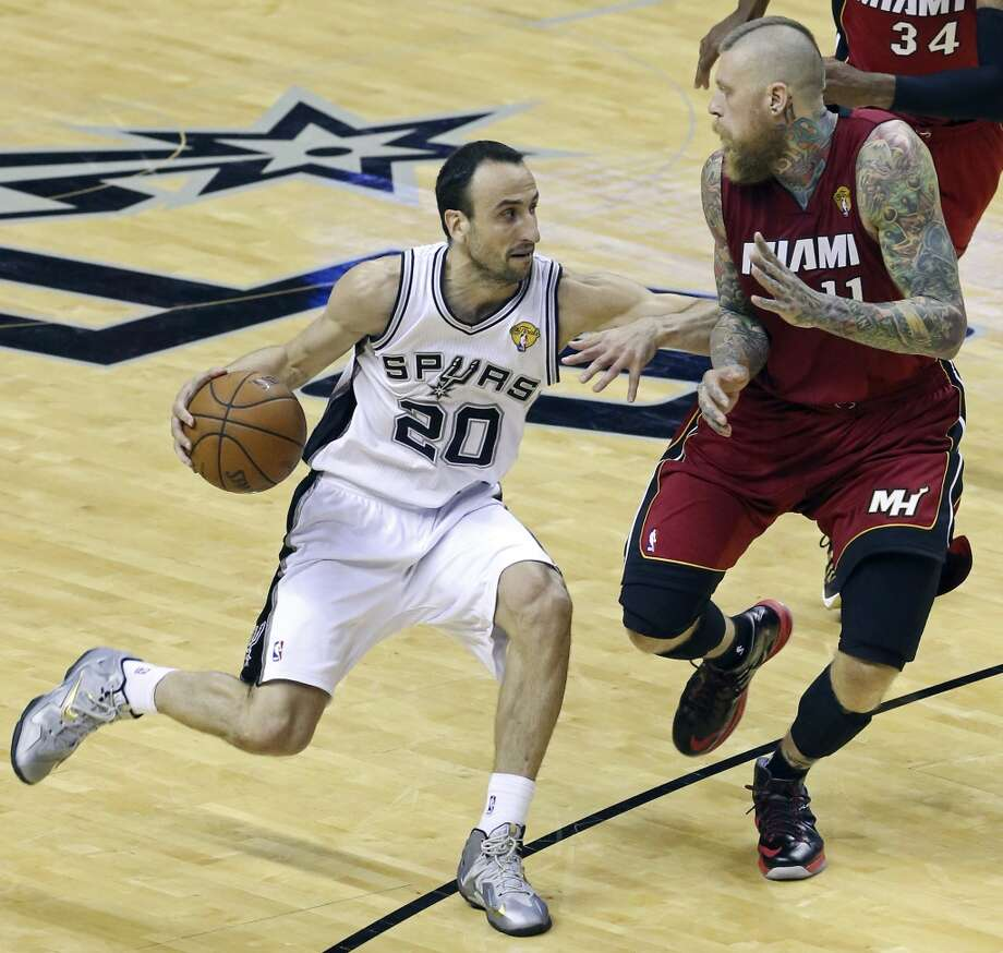 San Antonio Spurs' Manu Ginobili looks for room around Miami Heat's Chris Andersen during first half action in Game 1 of the NBA Finals Thursday June 5, 2014 at the AT&T Center. Photo: Edward A. Ornelas, San Antonio Express-News