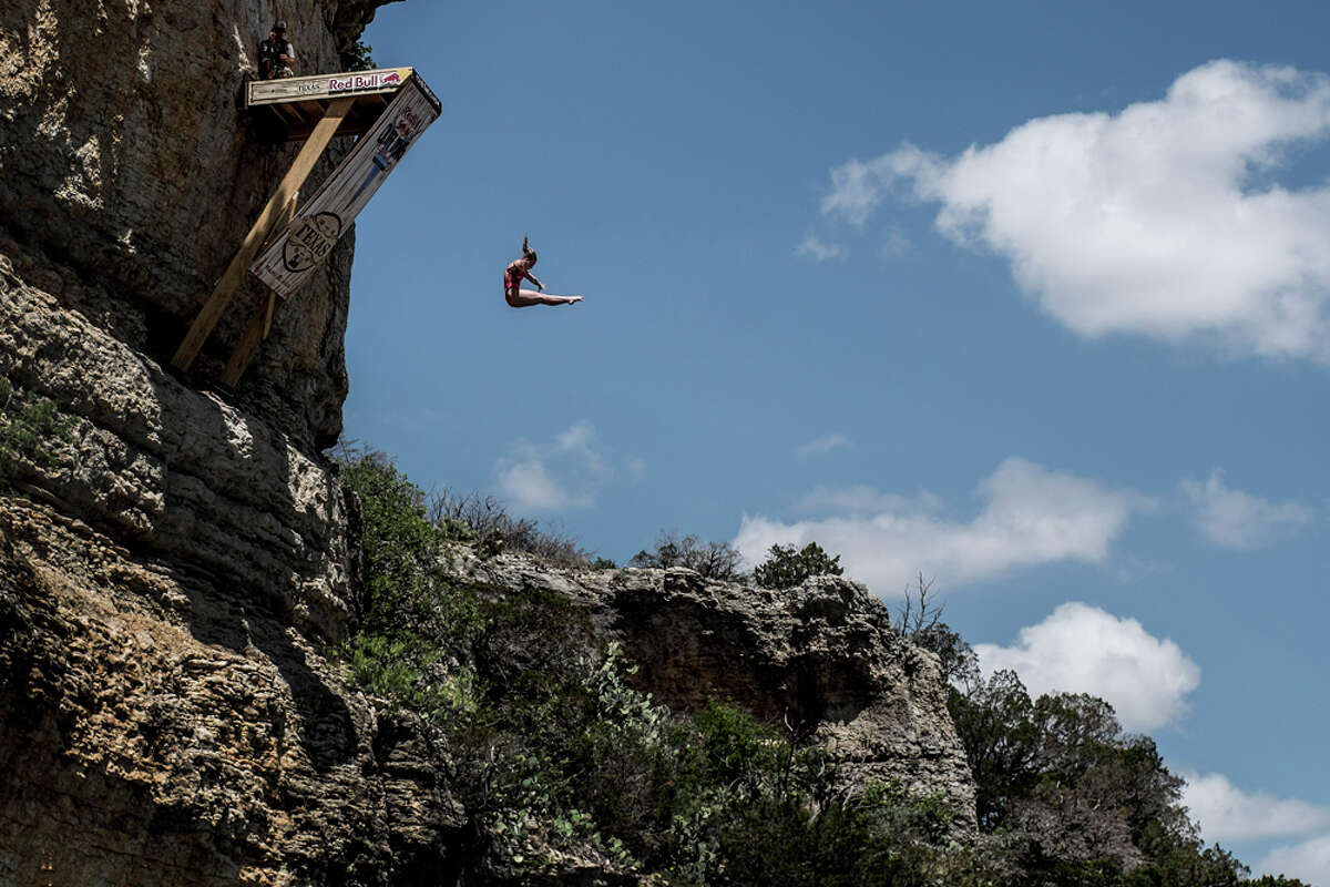 Rachelle Simpson of the USA dives from the 20-meter platform at Hells Gate during the first round of the second stop of the Red Bull Cliff Diving World Series on June 6, 2014 in Possum Kingdom Lake, Texas.