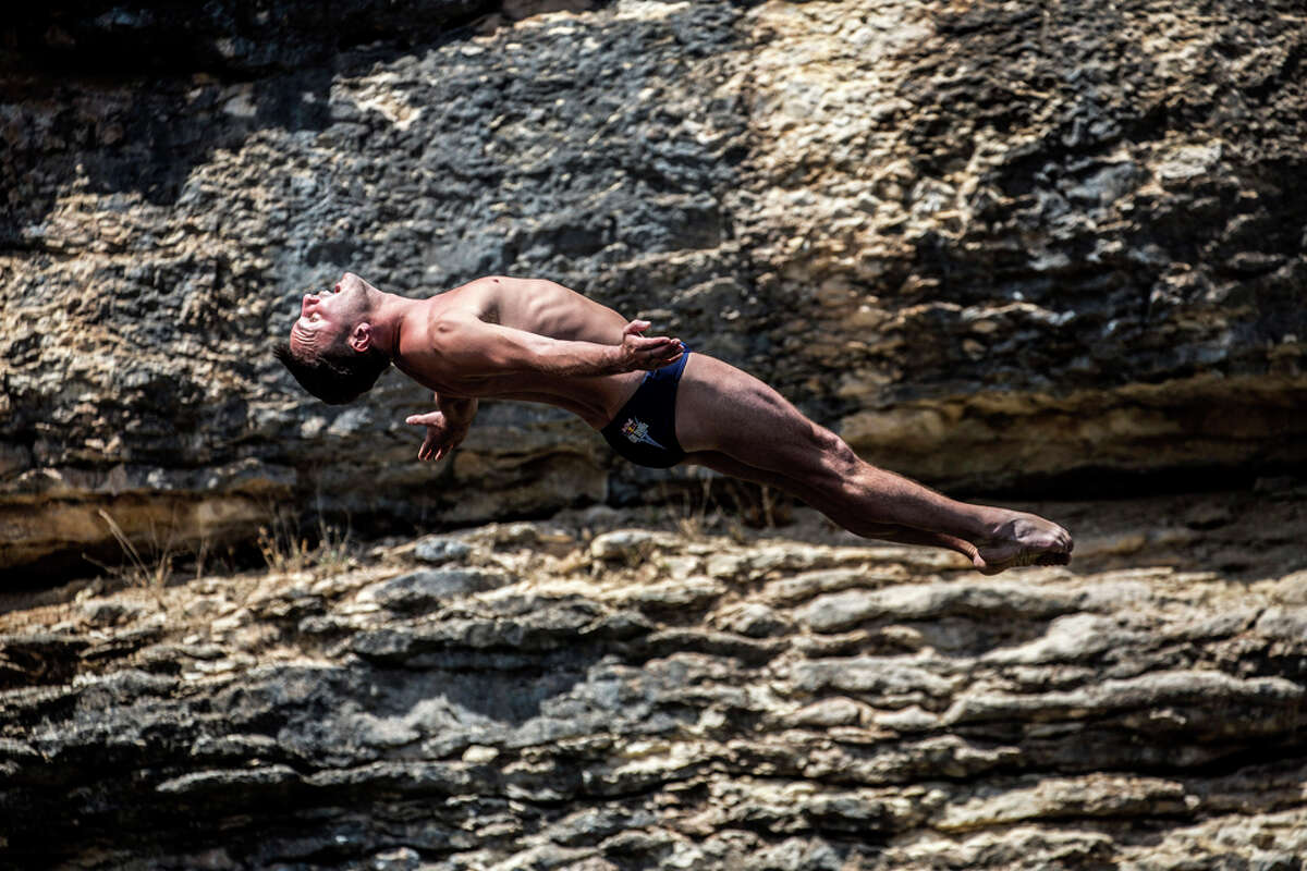 Blake Aldridge of the UK performs a warm up dive at Hells Gate during the second training session of the second stop of the Red Bull Cliff Diving World Series on June 6, 2014 in Possum Kingdom Lake, Texas.