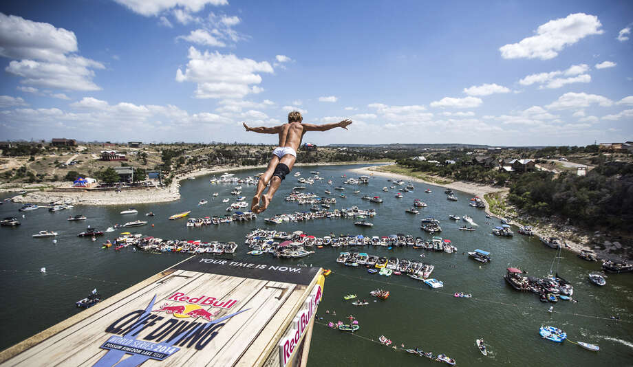 Anatoliy Shabotenko of the Ukraine dives from the 28-meter platform at Hells Gate during the seeding round of the second stop of the Red Bull Cliff Diving World Series on June 6, 2014 in Possum Kingdom Lake, Texas. Photo: Handout, Red Bull Via Getty Images / 2014 Red Bull