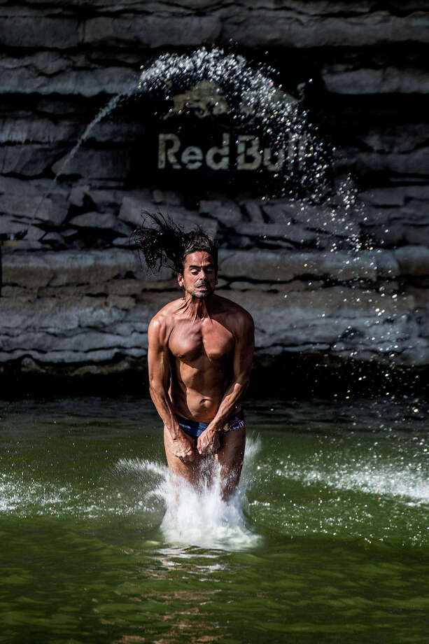 Orlando Duque of Colombia hits the water after diving from the 28-meter platform at Hells Gate during the second training session of the second stop of the Red Bull Cliff Diving World Series on June 6, 2014 in Possum Kingdom Lake, Texas. Photo: Handout, Red Bull Via Getty Images / 2014 Red Bull