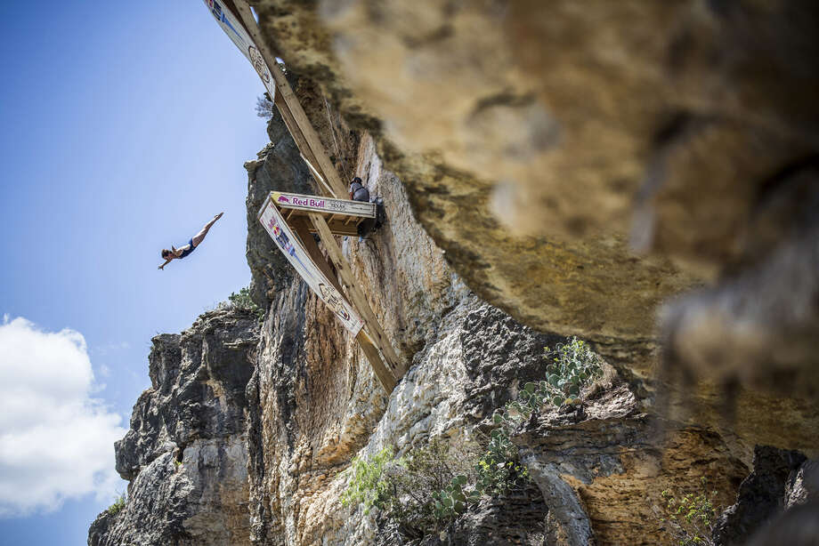 Ginger Huber of the USA dives from the 20-meter platform at Hells Gate during the second training session of the second stop of the Red Bull Cliff Diving World Series on June 6, 2014 in Possum Kingdom Lake, Texas. Photo: Handout, Red Bull Via Getty Images / 2014 Red Bull