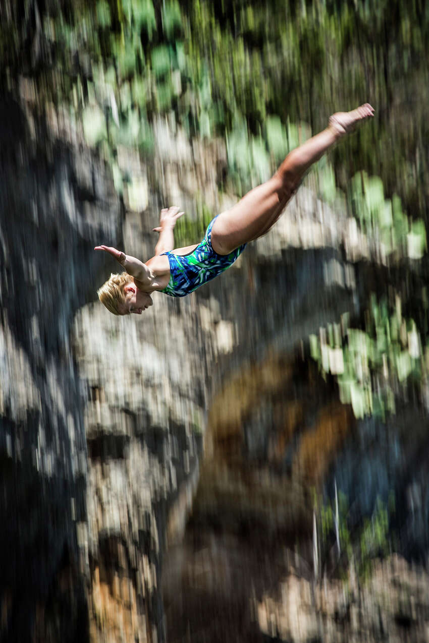 Cesilie Carlton of the USA dives from the 20-meter platform at Hells Gate during the second training session of the second stop of the Red Bull Cliff Diving World Series on June 6, 2014 in Possum Kingdom Lake, Texas.