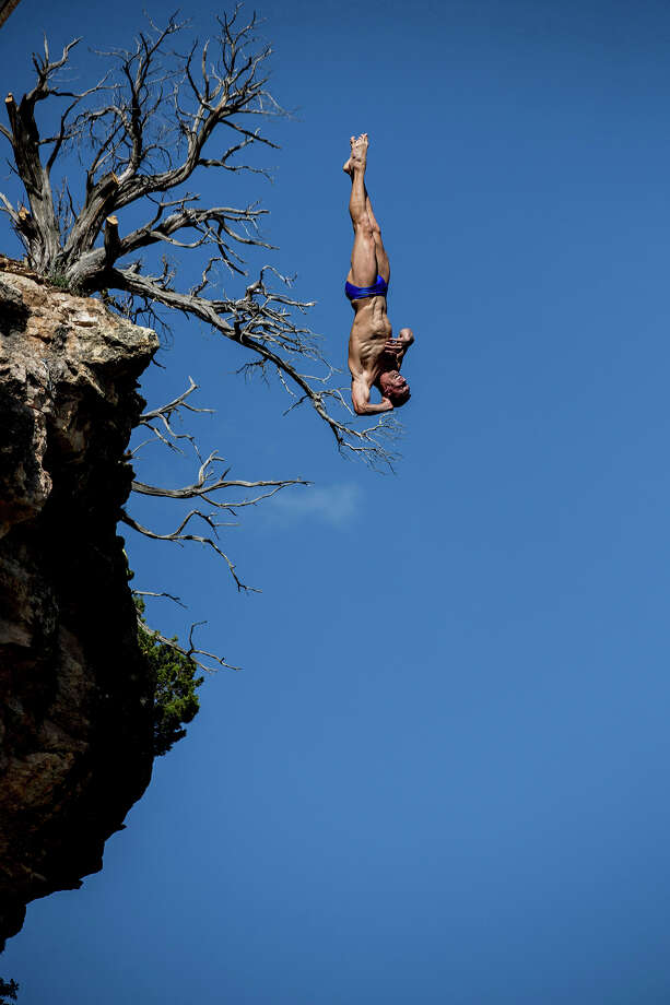 Michal Navratil of the Czech Republic dives from the 28-meter platform at Hells Gate during the second training session of the second stop of the Red Bull Cliff Diving World Series on June 6, 2014 in Possum Kingdom Lake, Texas. Photo: Handout, Red Bull Via Getty Images / 2014 Red Bull
