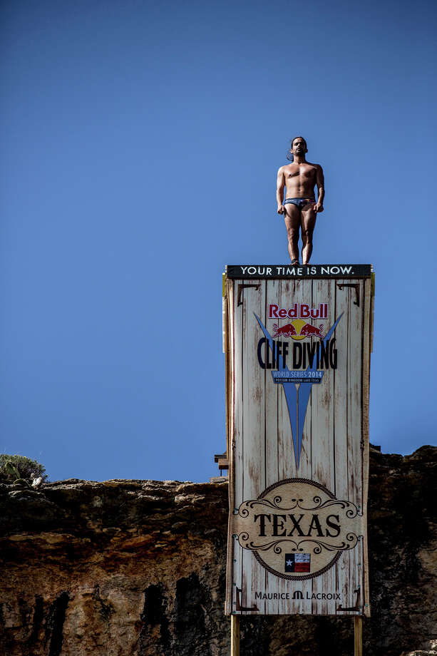 Orlando Duque of Colombia prepares to dive from the 28-meter platform at Hells Gate during the seeding round of the second stop of the Red Bull Cliff Diving World Series on June 6, 2014 in Possum Kingdom Lake, Texas. Photo: Handout, Red Bull Via Getty Images / 2014 Red Bull